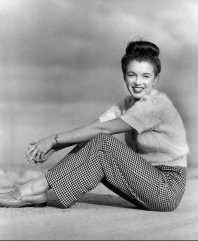 Marilyn Monroe wearing houndstooth slacks and angora sweater, mid 1940s.