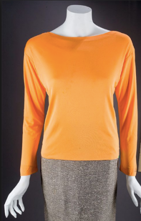 The same silk blouse worn during the George Barris photshoot. Sold at Julien's Auction House for $1900.00